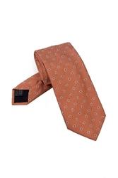 Elegancki poamarańczowy krawat jedwabny Van Thorn w białe paisley