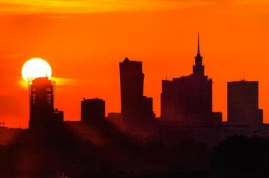 Warszawa zachód słońca wielka kula - plakat premium wymiar do wyboru: 140x100 cm
