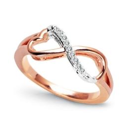 Staviori pierścionek. 9 diamentów, szlif brylantowy, masa 0,05 ct., barwa g, czystość si1. białe, różowe złoto 0,585. korona 16x7,6 mm. wysokość 3,6 mm. szerokość obrączki ok. 2,2 mm.