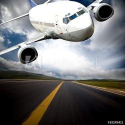Board z aluminiowym obramowaniem samolot z niebieskim tle nieba.