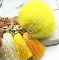 Brelok do torebki, żółty pompon z futerka z trzema chwostami - ciemne złoto, żółtym i białym