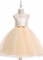 Tiulowa sukienka dla dziewczynki w kolorze szampańskim