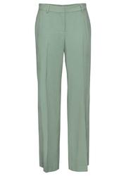 Spodnie z szerokimi nogawkami bonprix zielony pastelowy