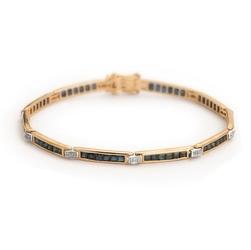 Staviori bransoleta 18cm. 10 diamentów, szlif brylantowy, masa 0,03 ct., barwa h, czystość i1. 60 szafirów, masa 4,80 ct.. żółte złoto 0,585. szerokość 3 mm.