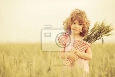 Obraz szczęśliwe dziecko jesienią
