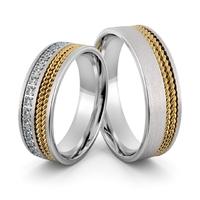 Obrączki srebrne z złotymi warkoczami i cyrkoniami - wzór ag-402
