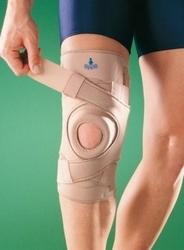 1033 stabilizator kolana z silikonowymi wzmocnieniami bocznymi oraz zapięciem krzyżowym
