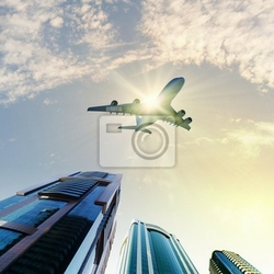 Fototapeta samolot nad miastem