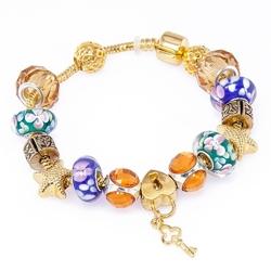 Bransoletka złota charms kwiaty klucz i kłódka
