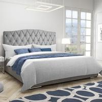 Eleganckie tapicerowane łóżko do sypialni varpen z zagłówkiem w stylu glamour