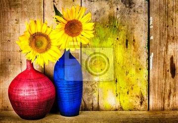 Obraz kolorowe wazony z słoneczniki na tle drewna