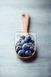 Obraz jagody na drewnianą łyżką