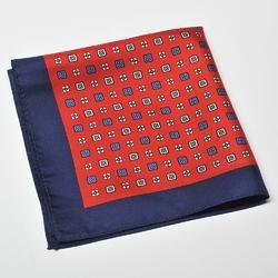 Czerwona poszetka w biały i niebieski wzór z granatową obwódką