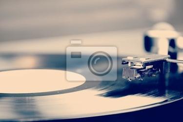 Plakat spinning płyty winylowej . motion blur obrazu . vintage stonowanych .