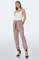 Beżowe damskie spodnie dresowe w kratę