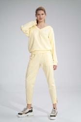 Bawełniane spodnie z rozciętą nogawką - żółte