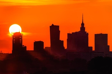 Warszawa zachód słońca wielka kula - plakat premium wymiar do wyboru: 70x50 cm