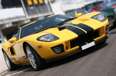 Super car at race circuit - fototapeta