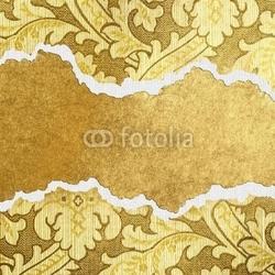 Obraz na płótnie canvas złote tło z rozdartego kartonu