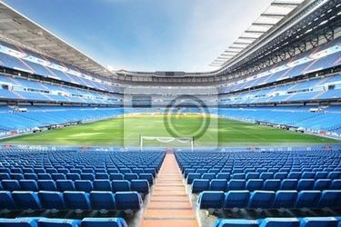 Fototapeta pusty stadion piłkarski z zewnątrz niebieskich foteli