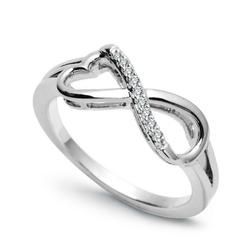Staviori pierścionek złoty nieskończoność. 9 diamentów, szlif brylantowy, masa 0,05 ct., barwa h, czystość si1-si2. białe złoto 0,585. średnica korony ok. 7,2x16 mm. wysokość 3,7 mm.