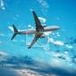 Fototapeta duży odrzutowiec latający na tle nieba idealny