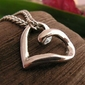 Zawinięte serce - srebrny wisior