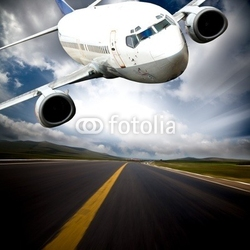 Obraz na płótnie canvas dwuczęściowy dyptyk samolot z niebieskim tle nieba.