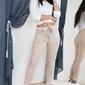 Spodnie dresowe pudrowy róż z kieszeniami ozdobionymi taśmą
