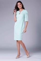 Miętowa elegancka dopasowana sukienka z drapowaniem na rękawie