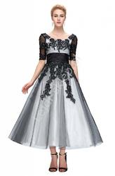 Suknia wieczorowa z gipiurowymi aplikacjami, czarno biała