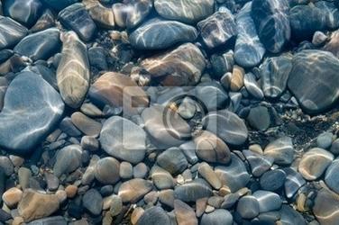 Fototapeta kamienie pod wodą.