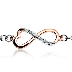 Staviori Bransoleta 18cm. 11 Diamentów, szlif brylantowy, masa 0,06 ct., barwa G, czystość SI1. Białe, Różowe Złoto 0,585. Wymiary 10x23 mm. Szerokość 3,9 mm.