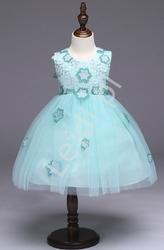 Jasno turkusowa sukienka tiulowa ozdobiona kwiatami dla dziewczynek