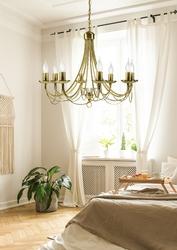 Duży żyrandol złoty na osiem żarówek świec muza candellux 38-69187