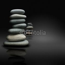 Obraz na płótnie canvas trzyczęściowy tryptyk Relaks na czarnym tle, kamienie ułożone postawy zen