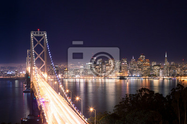 Fototapeta Panorama di San Francisco e Bay Bridge di notte
