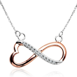Staviori naszyjnik 42cm. 11 diamentów, szlif brylantowy, masa 0,05 ct., barwa g, czystość si1. białe, różowe złoto 0,585. wymiary 22x11 mm.