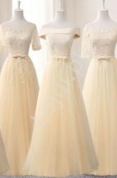 Szampańska suknia wieczorowa z koronką i delikatnie odsłoniętymi ramionami