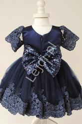 Granatowa sukienka dla dziewczynki zdobiona koronką i cekinową kokardą