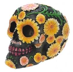 Czarna czaszka ozdobiona kwiatami - figurka