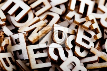 Obraz pomieszane drewniane litery z bliska