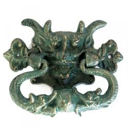 Zielony demon - żeliwna kołatka do drzwi