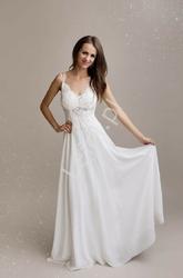 Wspaniała suknia ślubna, delikatna i bardzo kobieca 1359