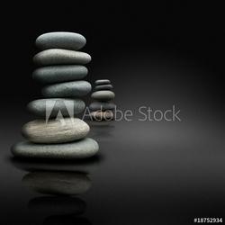 Obraz na płótnie canvas dwuczęściowy dyptyk relaks na czarnym tle, kamienie ułożone postawy zen