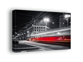 Warszawa nocne ulice mknący tramwaj - obraz na płótnie wymiar do wyboru: 70x50 cm