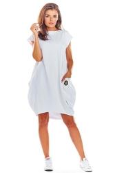 Oversizowa biała sukienka z dużymi kieszeniami