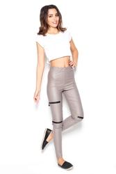 Beżowe dopasowane spodnie z suwakami