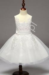 Biała dziecięca sukienka tiulowa z brokatem na spódnicy na komunię