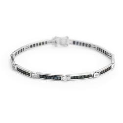 Staviori bransoleta 18cm. 37 diamentów, szlif brylantowy, masa 0,32 ct., barwa g-h, czystość si1. 60 szafirów, masa 3,43 ct.. białe złoto 0,750. szerokość 3 mm.